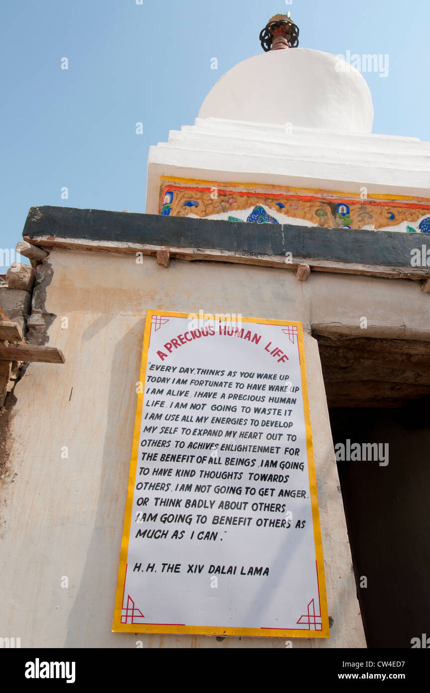 A Precious Human Life, a writing by the Dalai Lama on how to lead a full life on the wall of a temple in Leh, Ladakh, - Stock Image