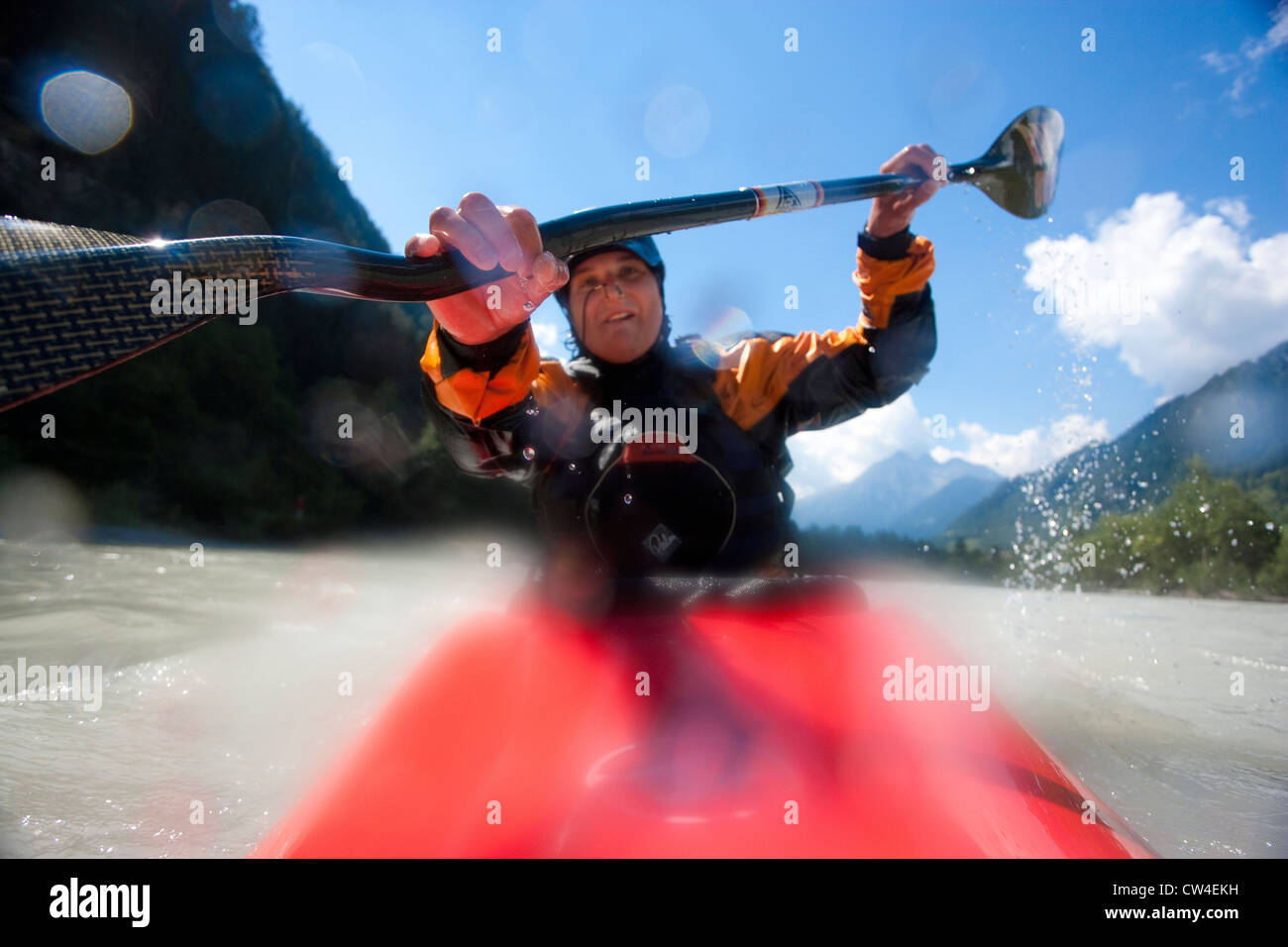 Whitewater kayaker paddling on Inn River near Pfunds, Austria - Stock Image