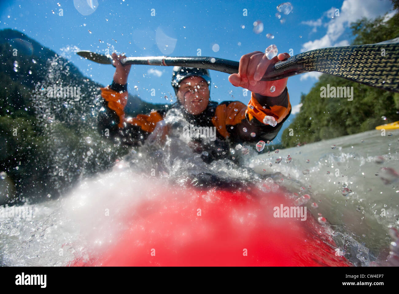 Whitewater kayaker riding rapid on Inn River near Pfunds, Austria - Stock Image