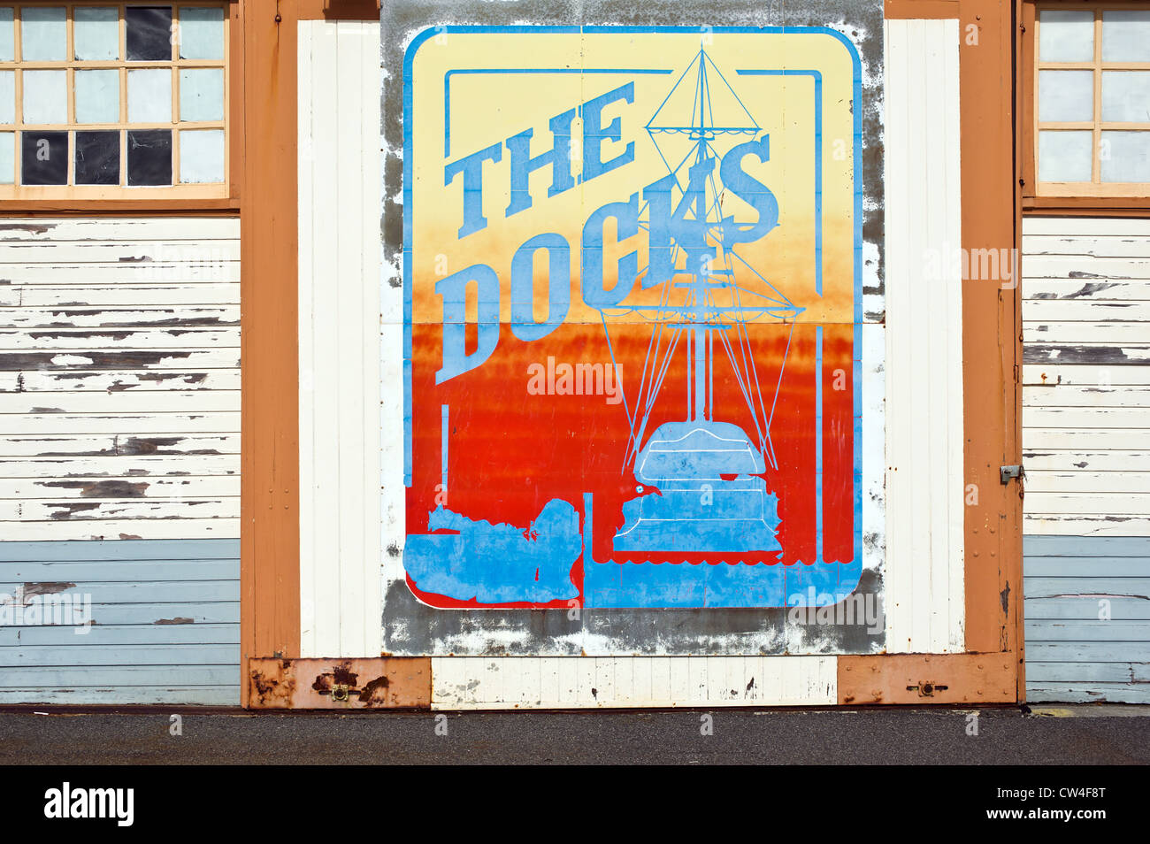 Fremantle Western Australia - A graphic art design painted on the door of a wooden building in the Port of Fremantle - Stock Image
