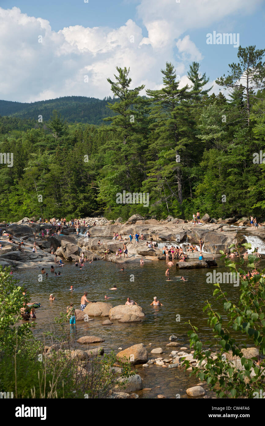 Swimmers on a hot summer afternoon at the lower falls of the Swift River in White Mountain National Forest. - Stock Image