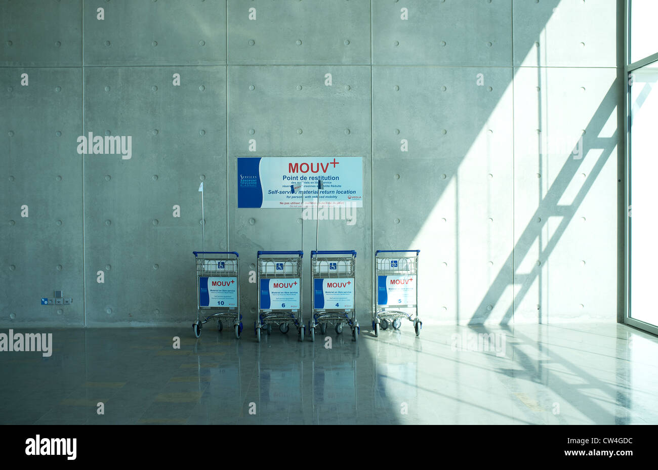 Return point for luggage trolleys for people with reduced mobility Toulouse Airport France - Stock Image