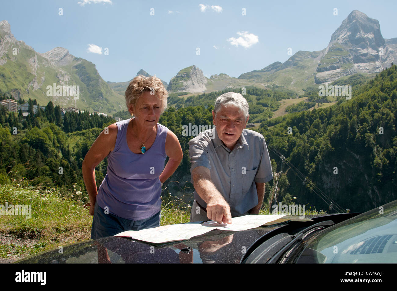 Map Of France With Mountains.Motorists Map Reading With A Backdrop Of Mountains South West France