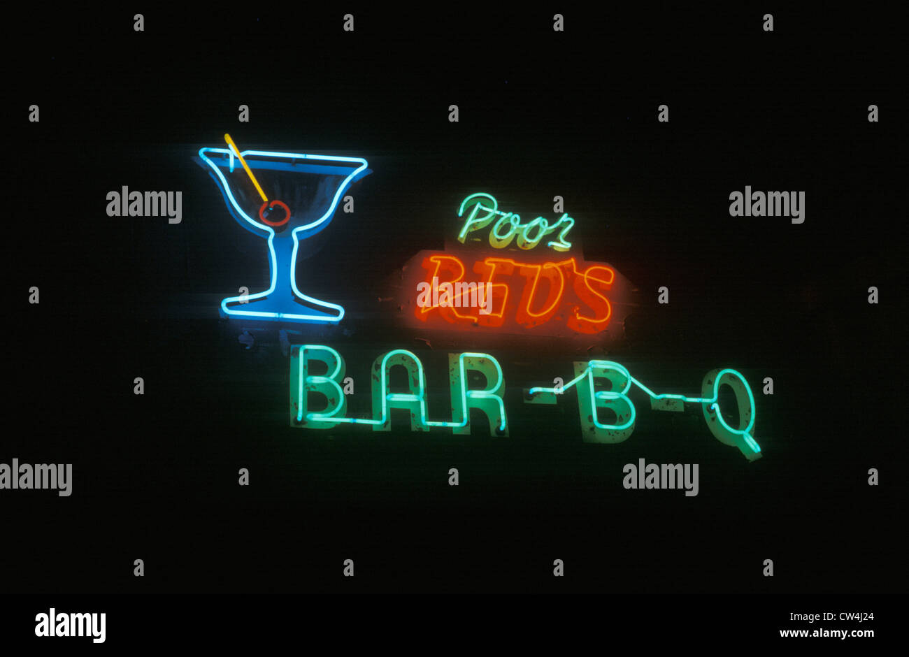 A neon sign that reads ?Poor Red's Bar-B-Q? - Stock Image