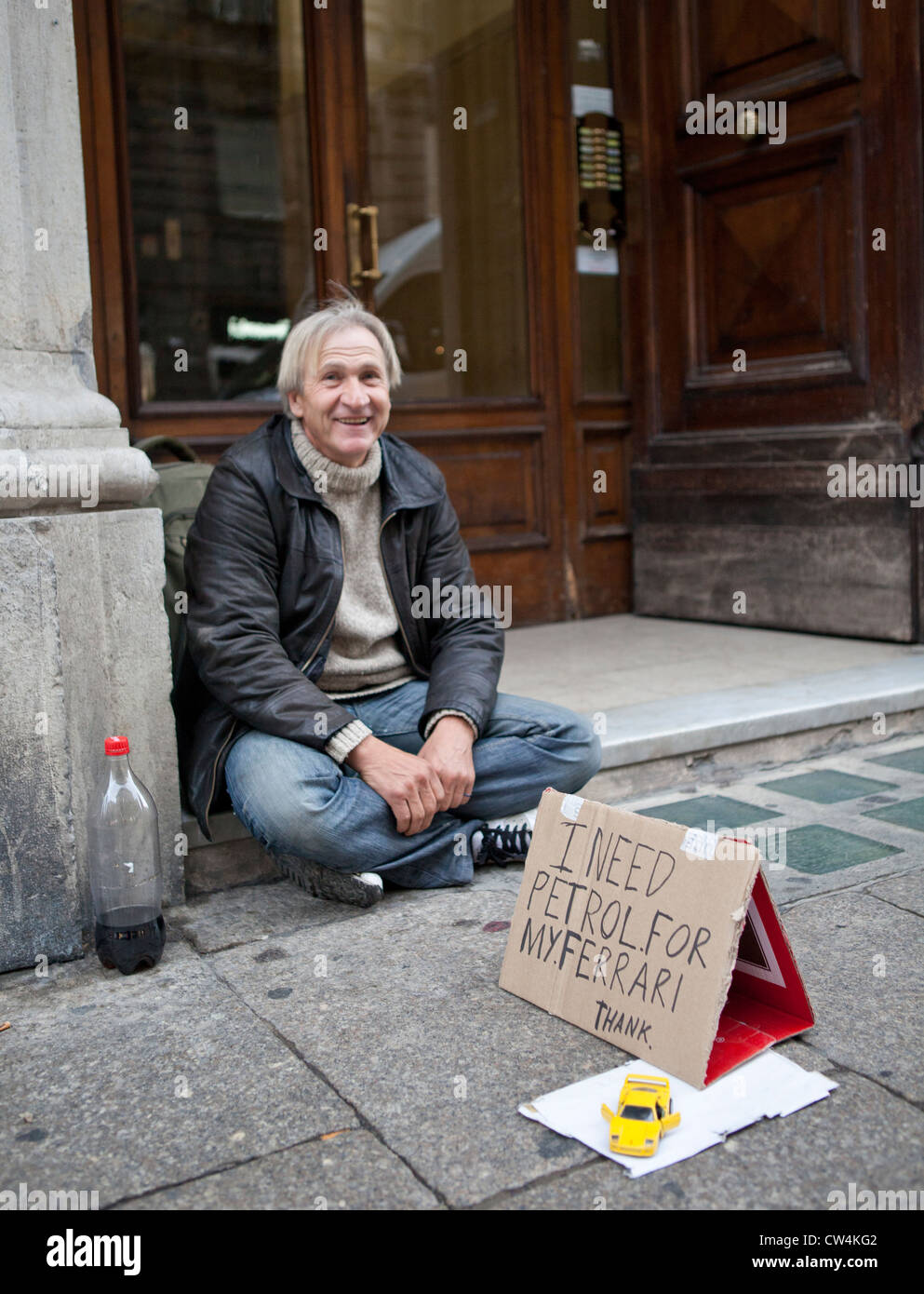 Homeless man on street begging, Genoa, Italy - Stock Image