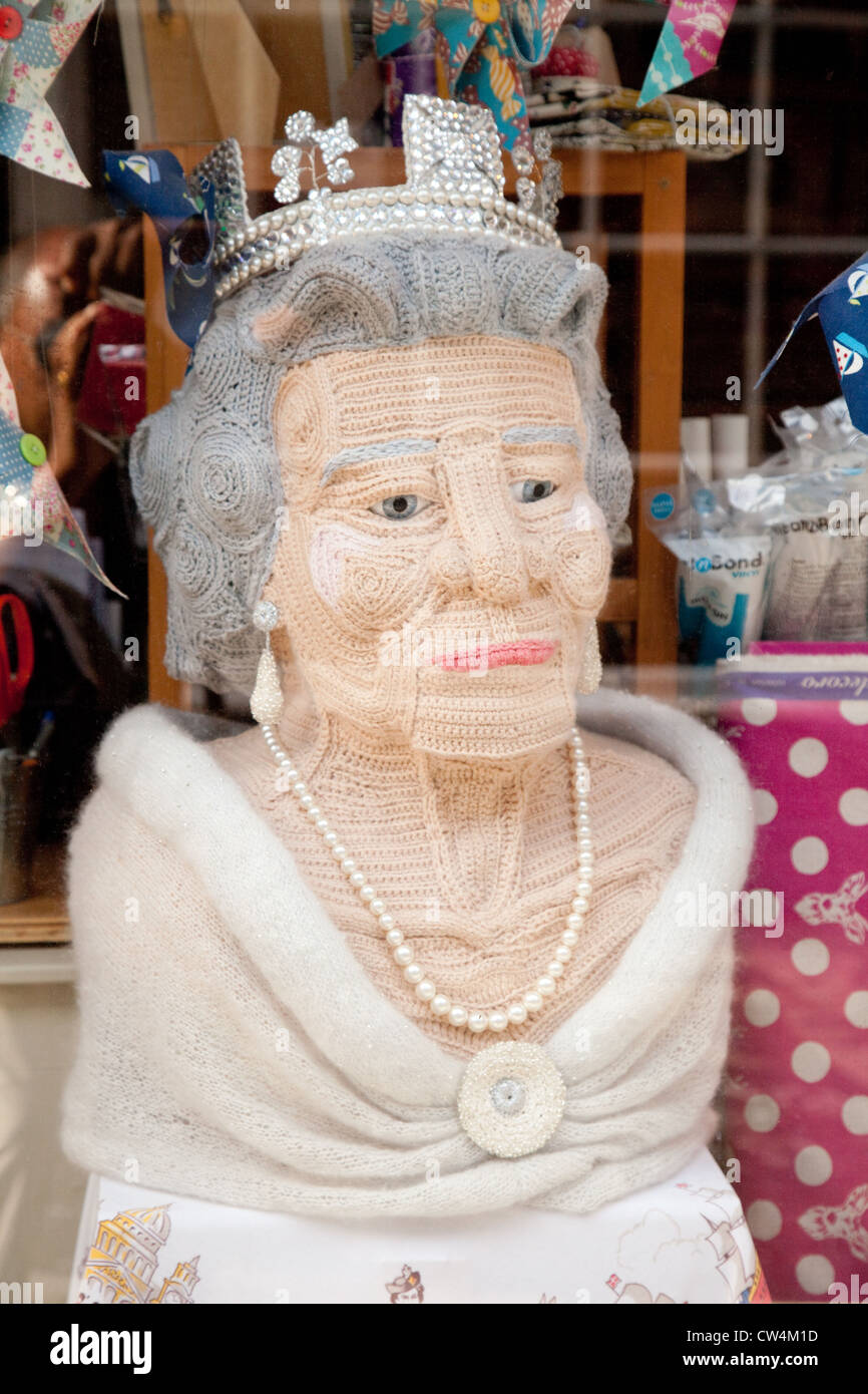 A knitted doll likeness of Queen Elizabeth II of the UK in a shop window, Bath, Somerset UK - Stock Image