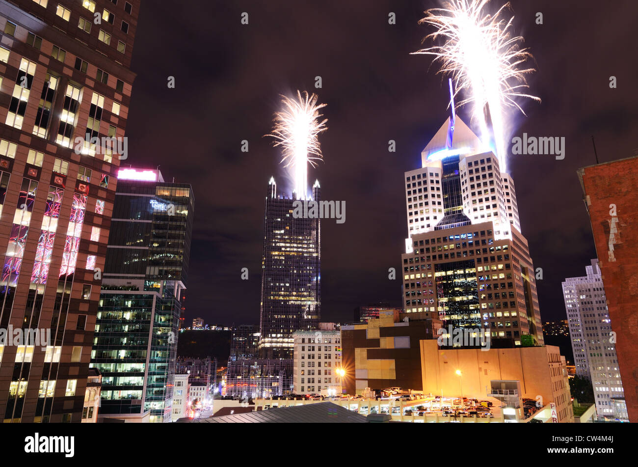 Fireworks launch from skyscrapers in downtown Pittsburgh, Pennsylvania, USA. Stock Photo