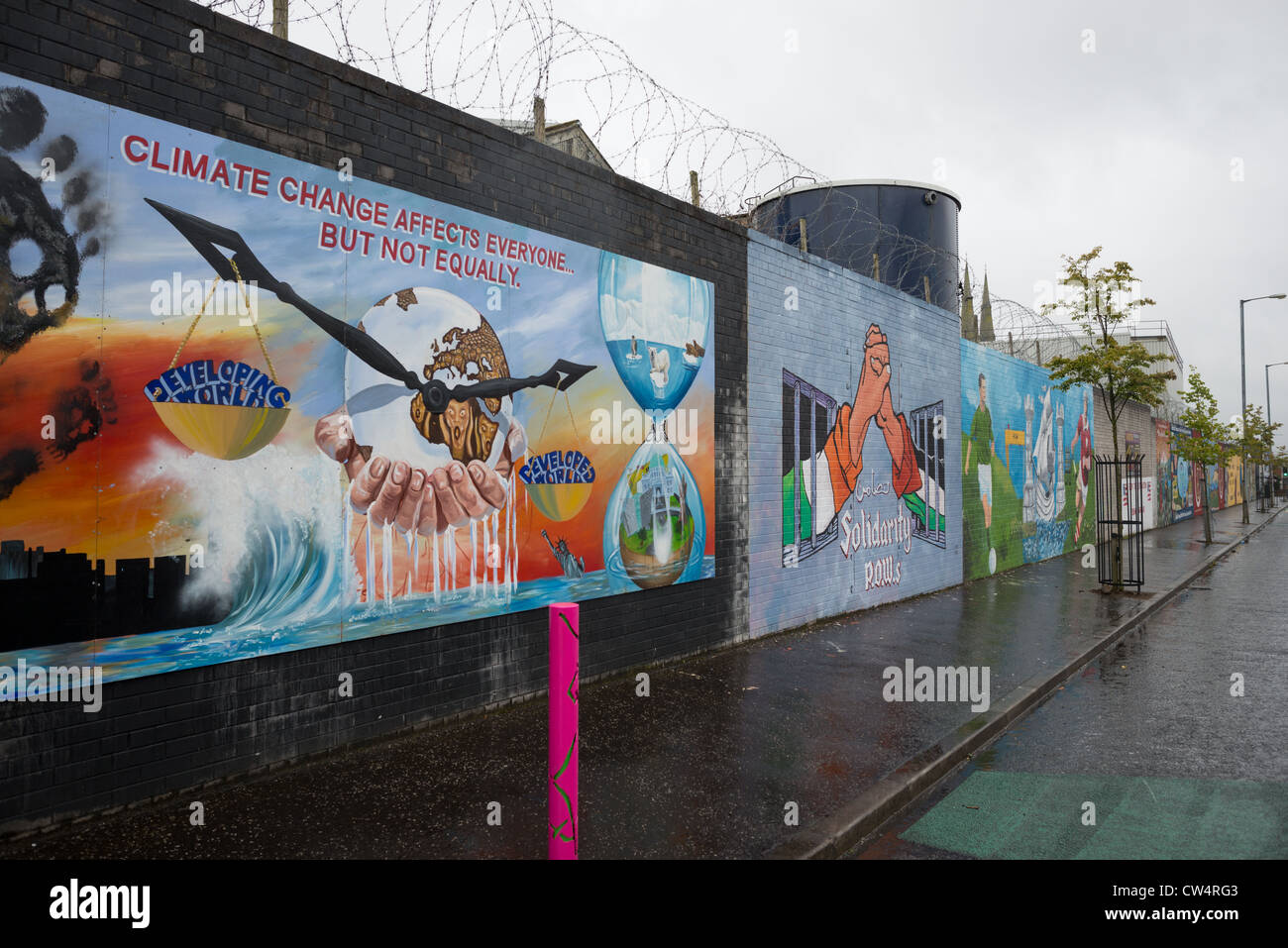 Political mural off Catholic Falls road, Belfast in Northern Ireland. - Stock Image
