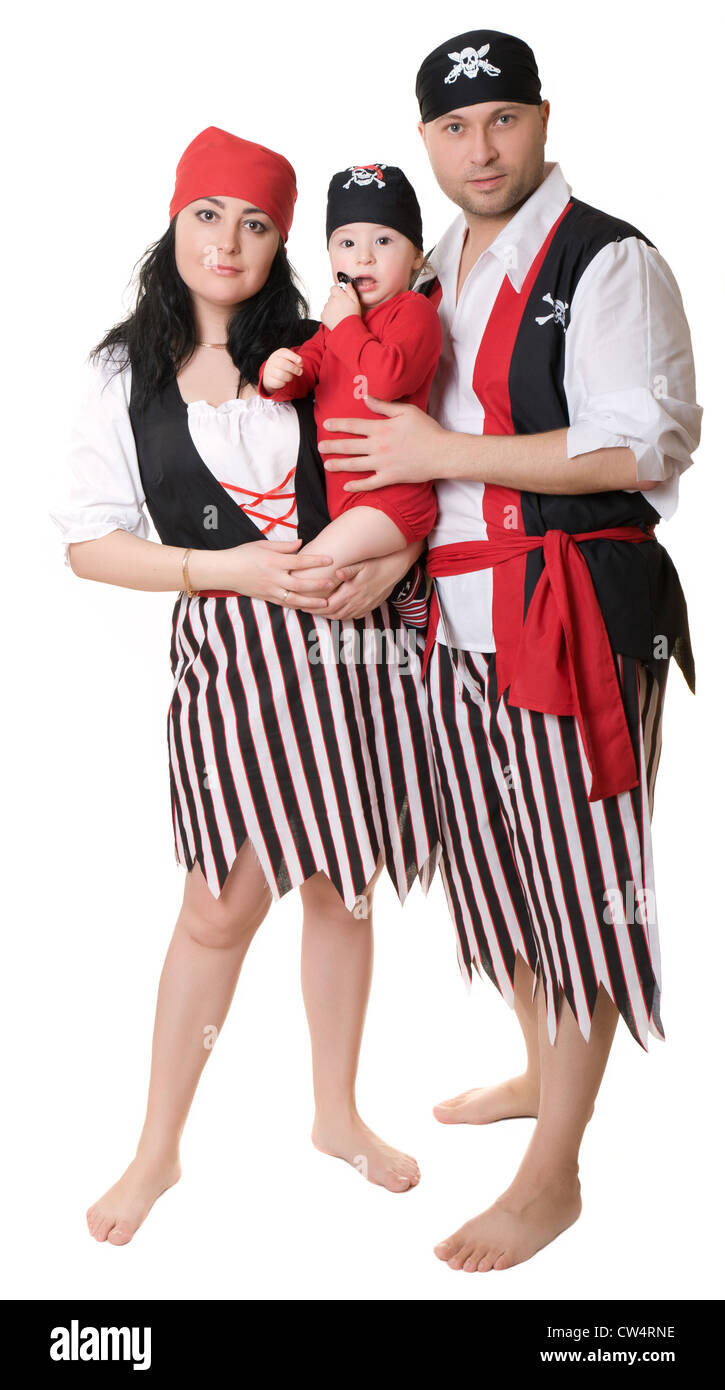A man and a woman holding a baby dressed in pirate costume. - Stock Image