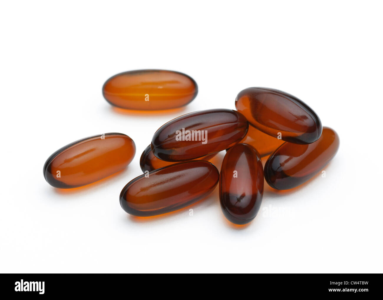 Flaxseed oil pills, a nutritional source of omega-3 and omega-6 fatty acids - Stock Image