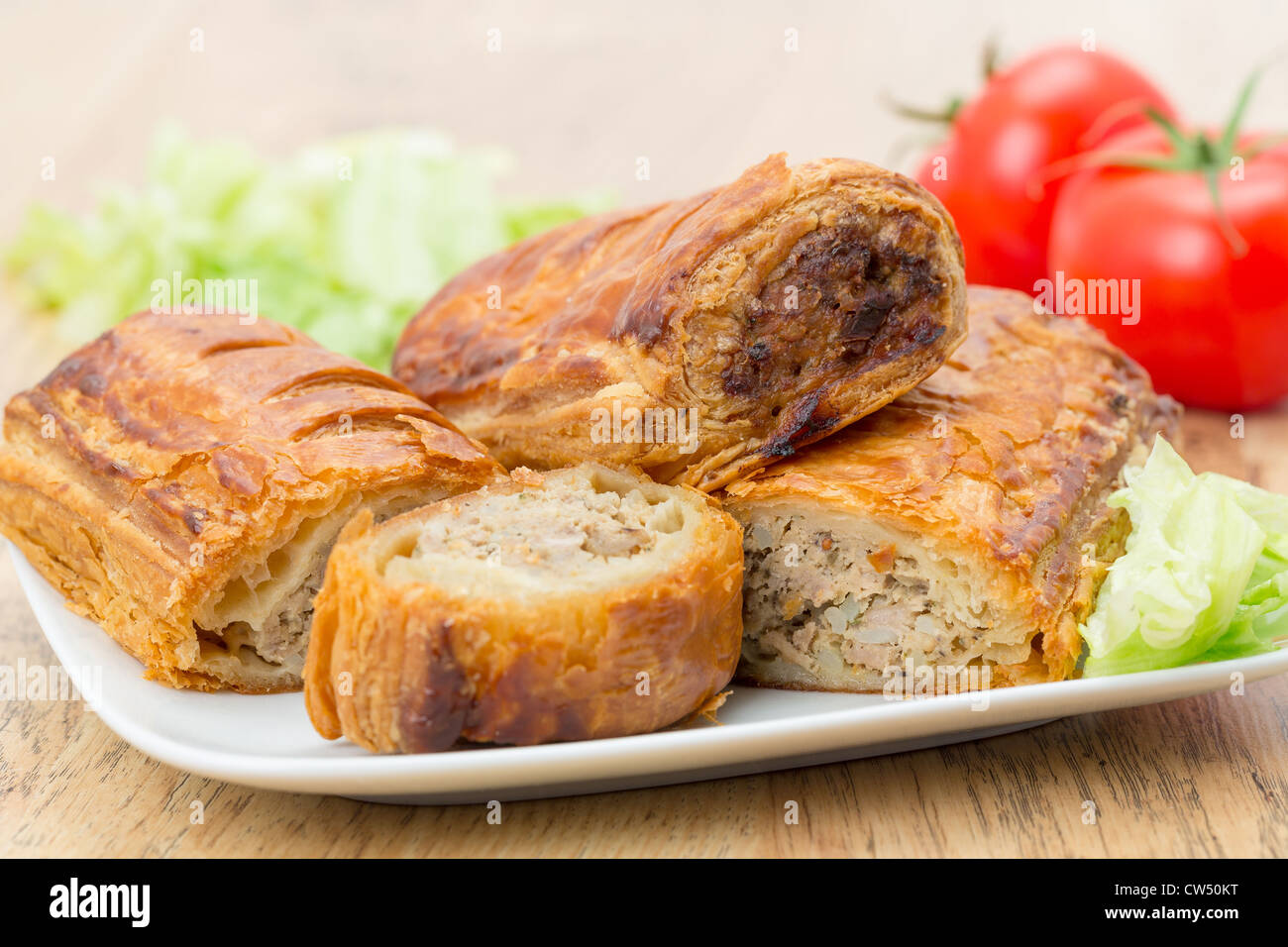 Sausage rolls in flaky puff pastry - Stock Image
