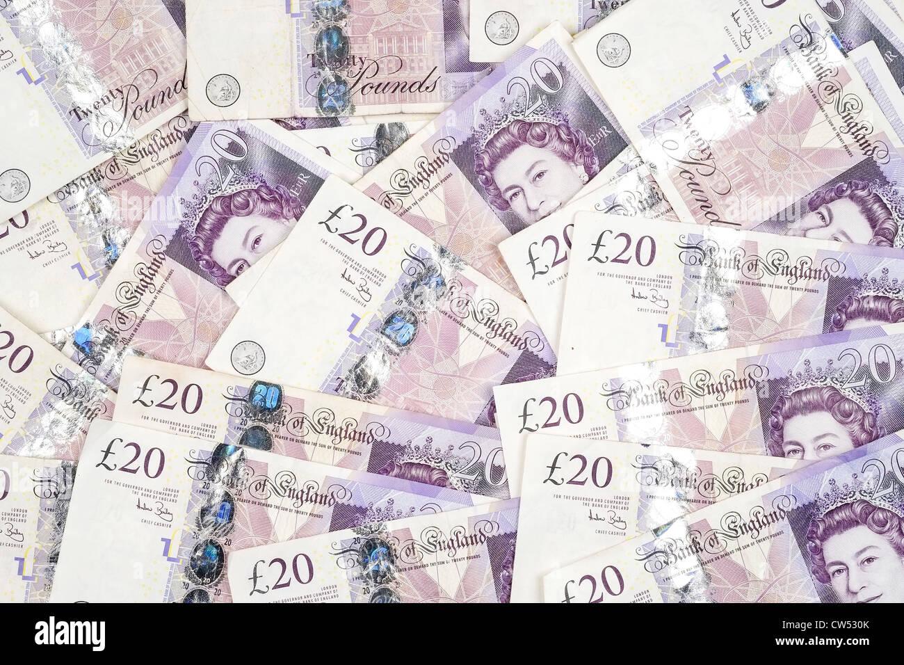 A background image of UK twenty pound notes - Stock Image