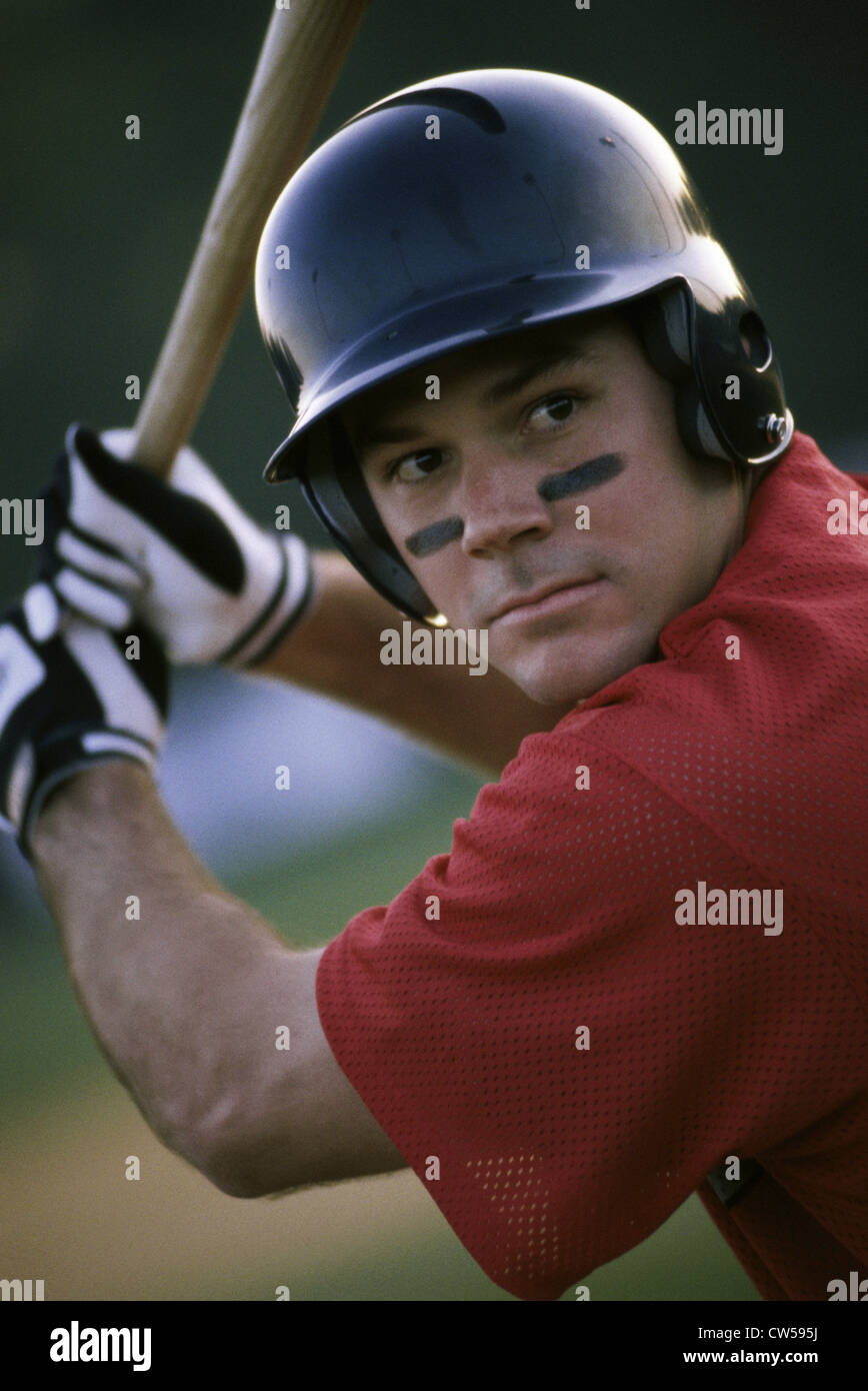 Baseball player swinging a baseball bat Stock Photo