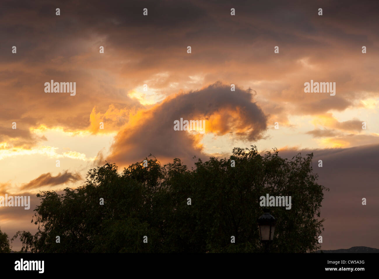 Unusual wave like cloud formation with beautiful colours in setting sun, La Rioja, Spain, Europe. - Stock Image