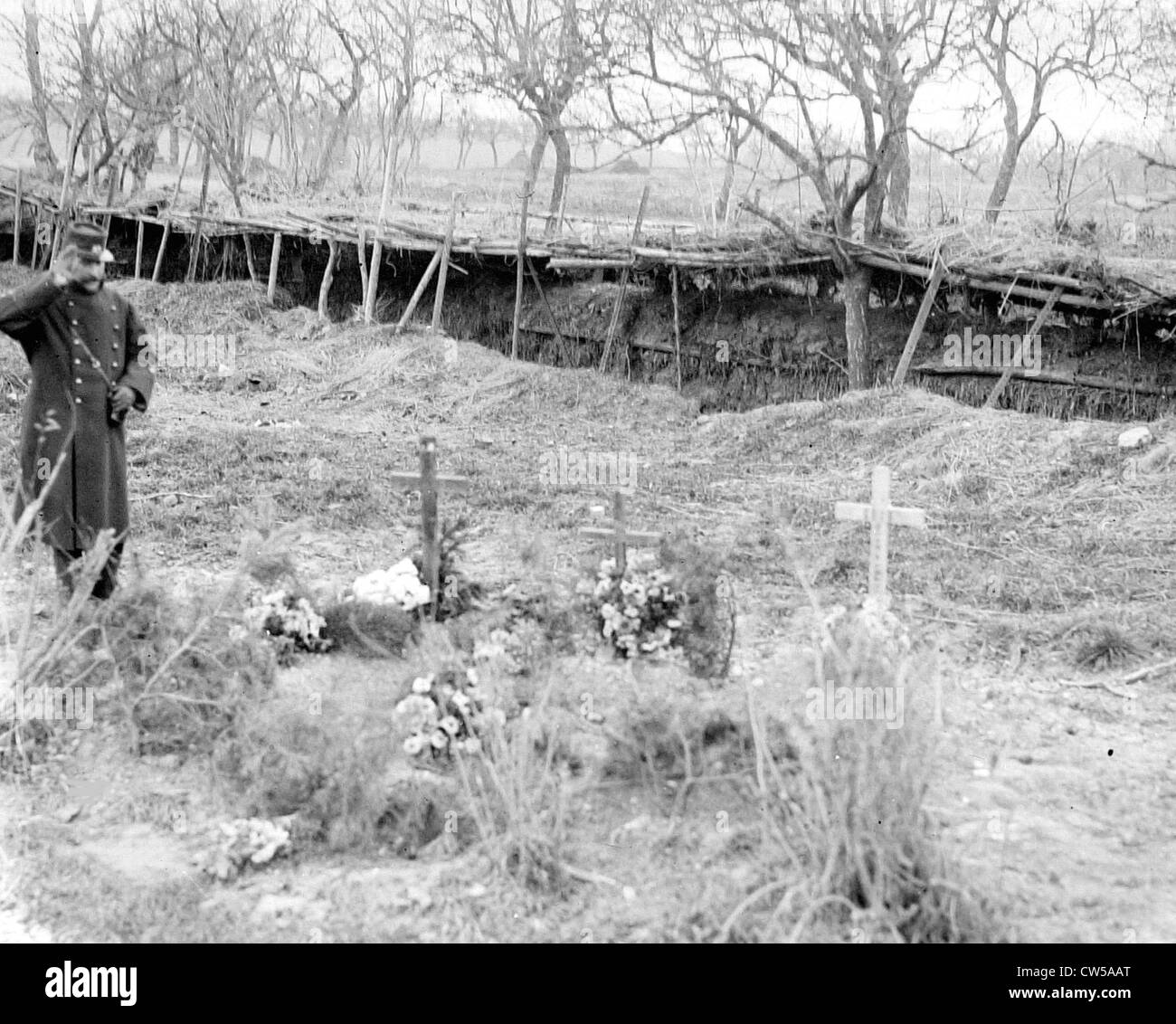 A visit to the east, saluting the dead in front of a trench - Stock Image
