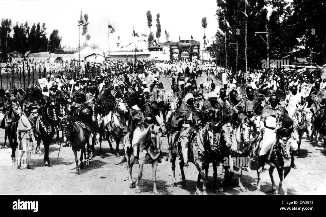 Ras, tribal chieftains and warriors leaving Addis Ababa for the front, accompanied by the imperial guard - Stock Image