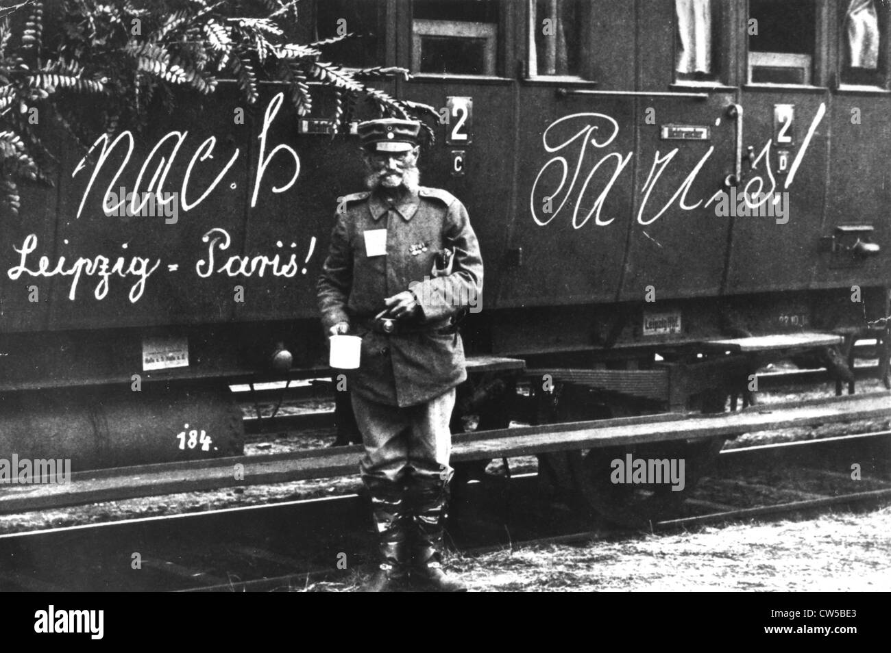 Germany, soldier in front of a train marked 'To Paris!' - Stock Image