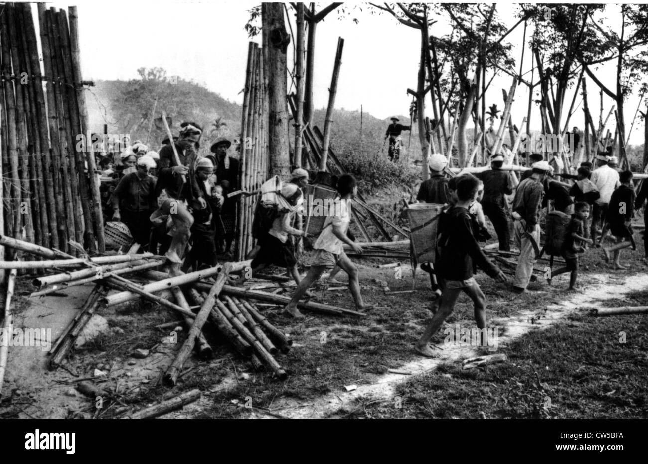 South Vietnamese civilians passing an enemy barricade to go home - Stock Image