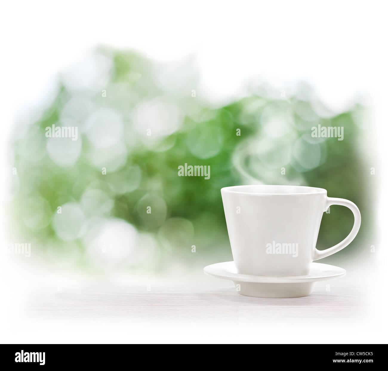 Cup of hot drink on defocus summer background - Stock Image