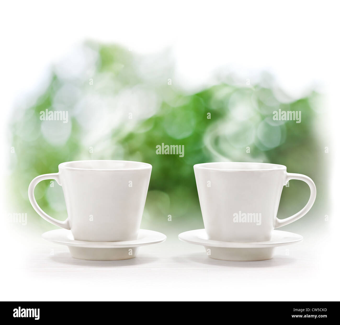 Cups of hot drink on defocus summer background - Stock Image