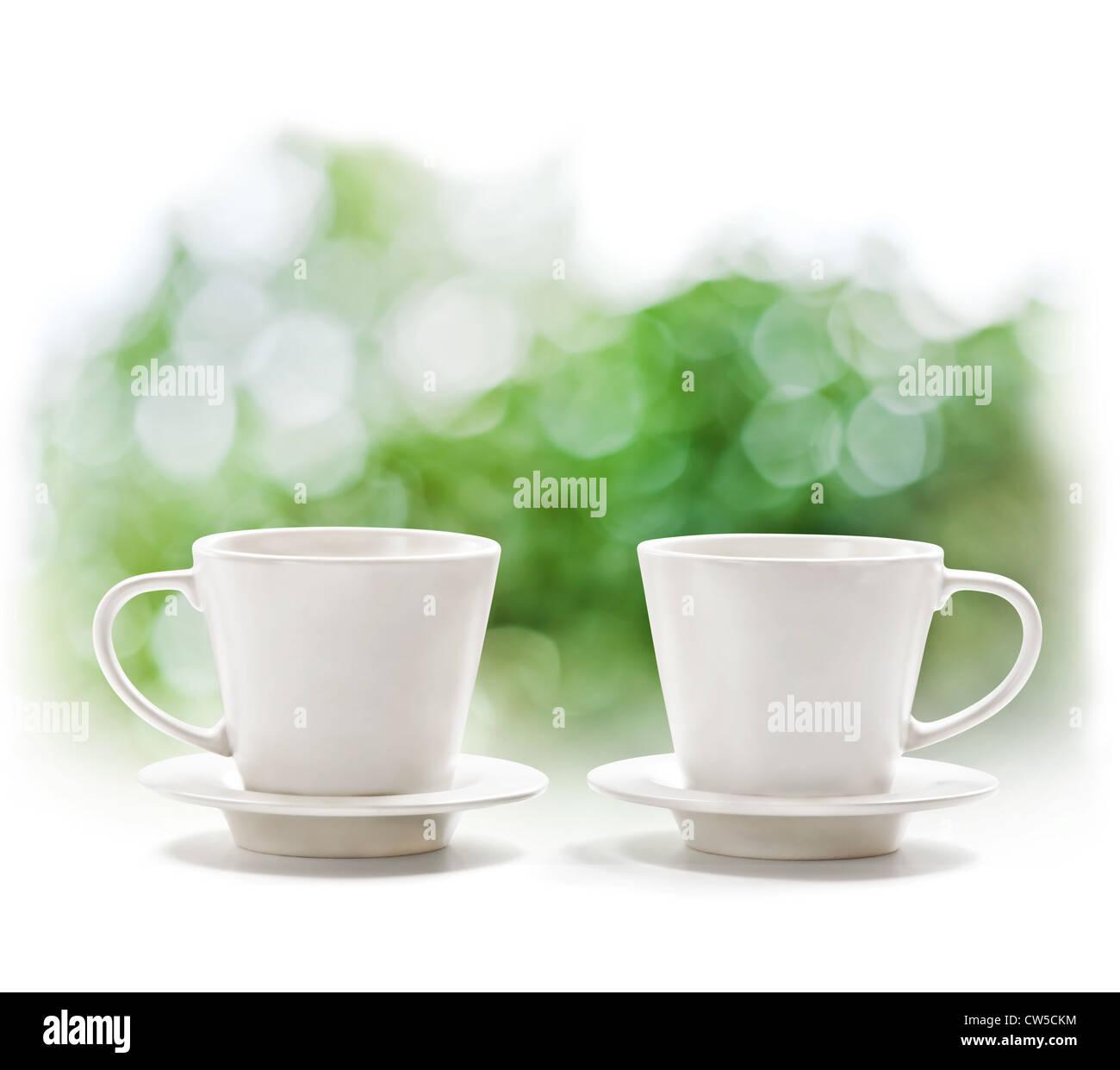 Cups on defocus summer background - Stock Image