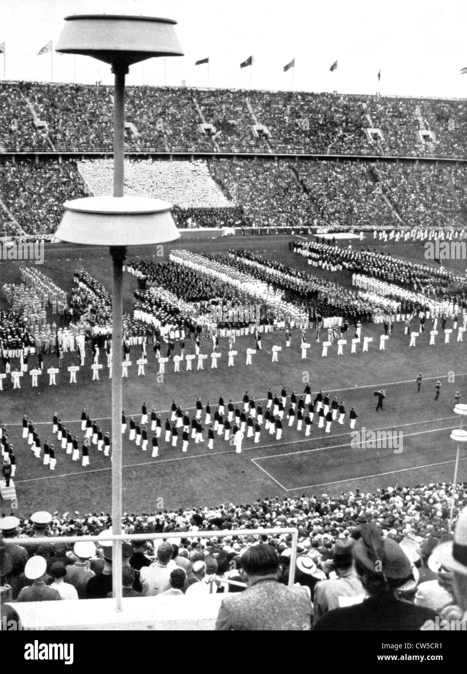 Berlin Olympic Games Berlin Olympic Games Nations parade on the opening day. In the foreground, the Swiss team - Stock Image