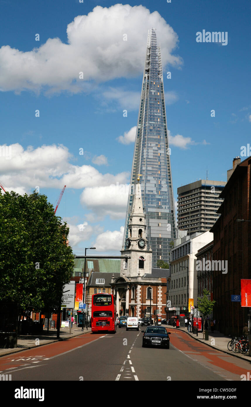 View up Borough High Street past St George The Martyr church to the Shard, London, UK - Stock Image