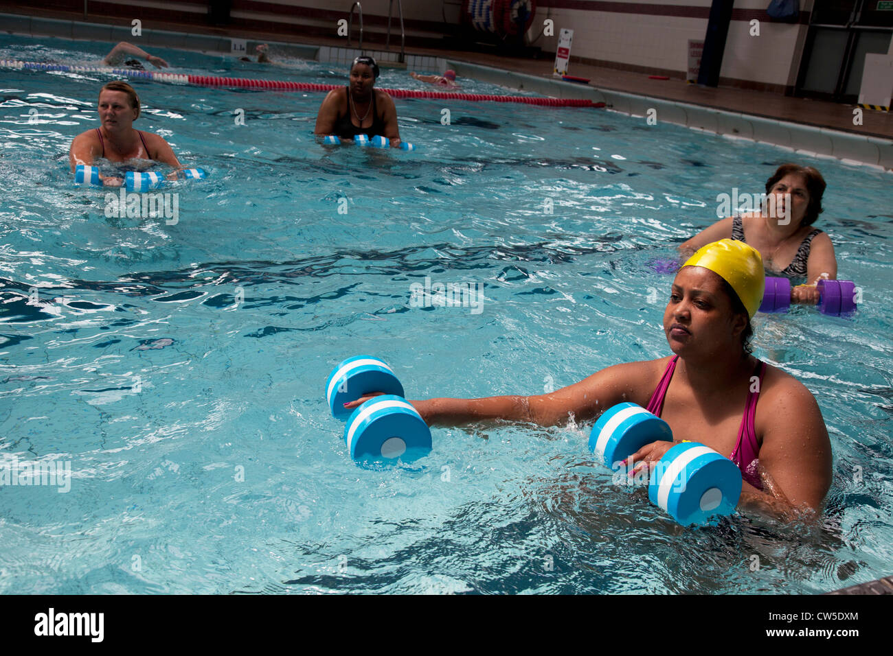 Exercise class at Cally Pool swimming pool, London. People join the ...