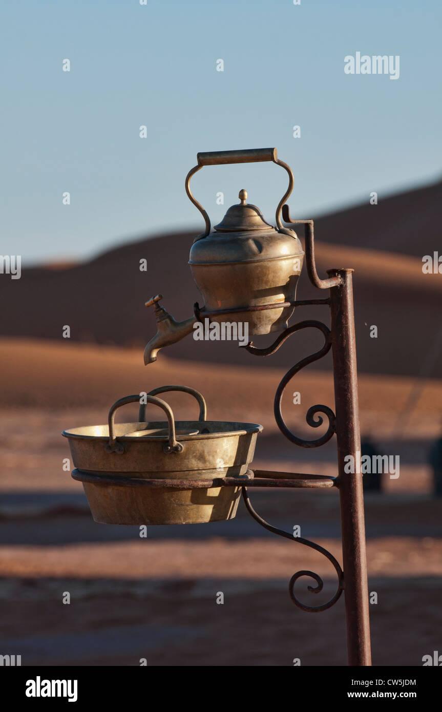 Saharan water spigot, Erg Chigaga, Morocco - Stock Image