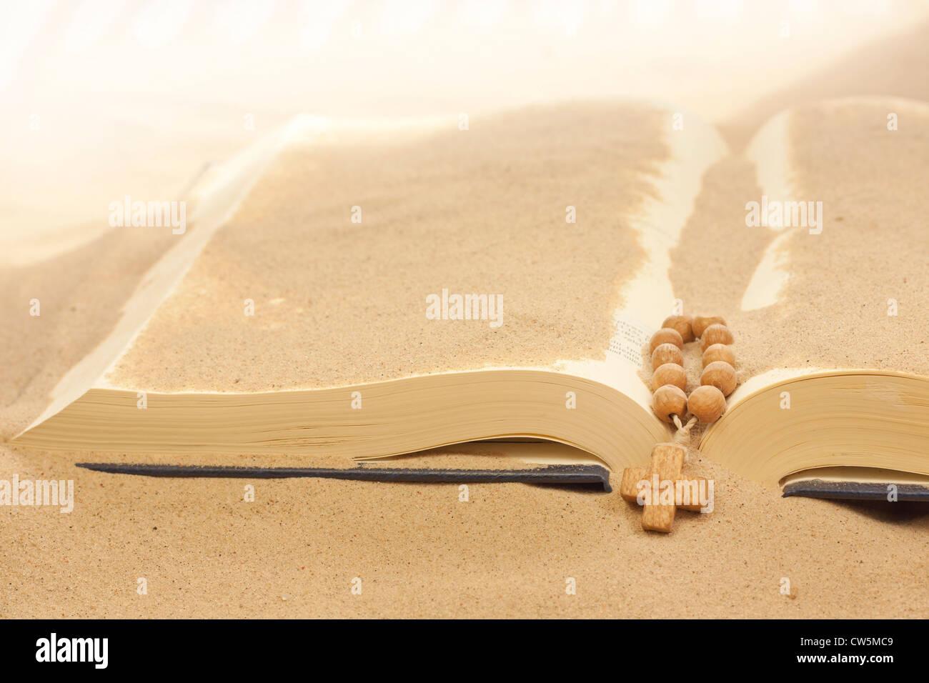 Loss of faith forgotten words of Bible religion concept on desert in sand - Stock Image