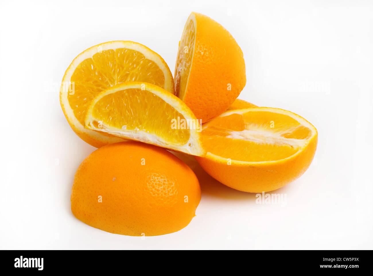 Oranges sliced on white background - Stock Image