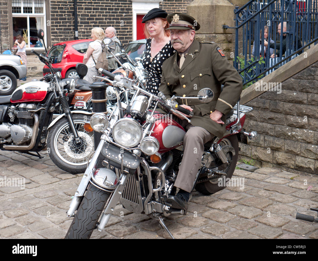 US Army Officer on a modern motorbike, re-enactment weekend at Uppermill, Saddleworth,Greater Manchester,UK. - Stock Image