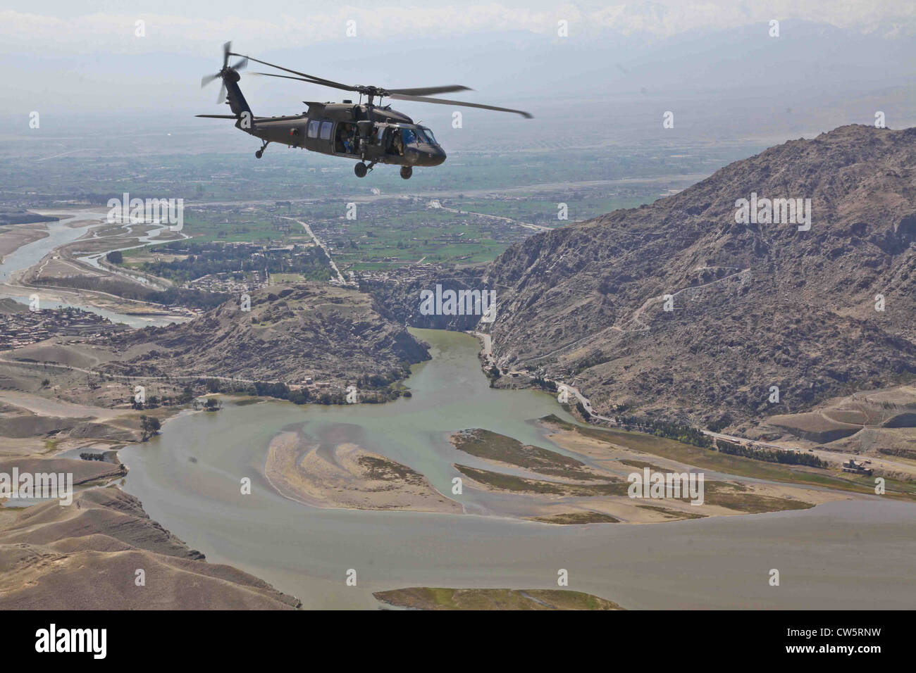 An US Army UH-60 Black Hawk Helicopter is flying to Forward Operating Base Torkham March 28, 2012 in Nangarhar province, - Stock Image
