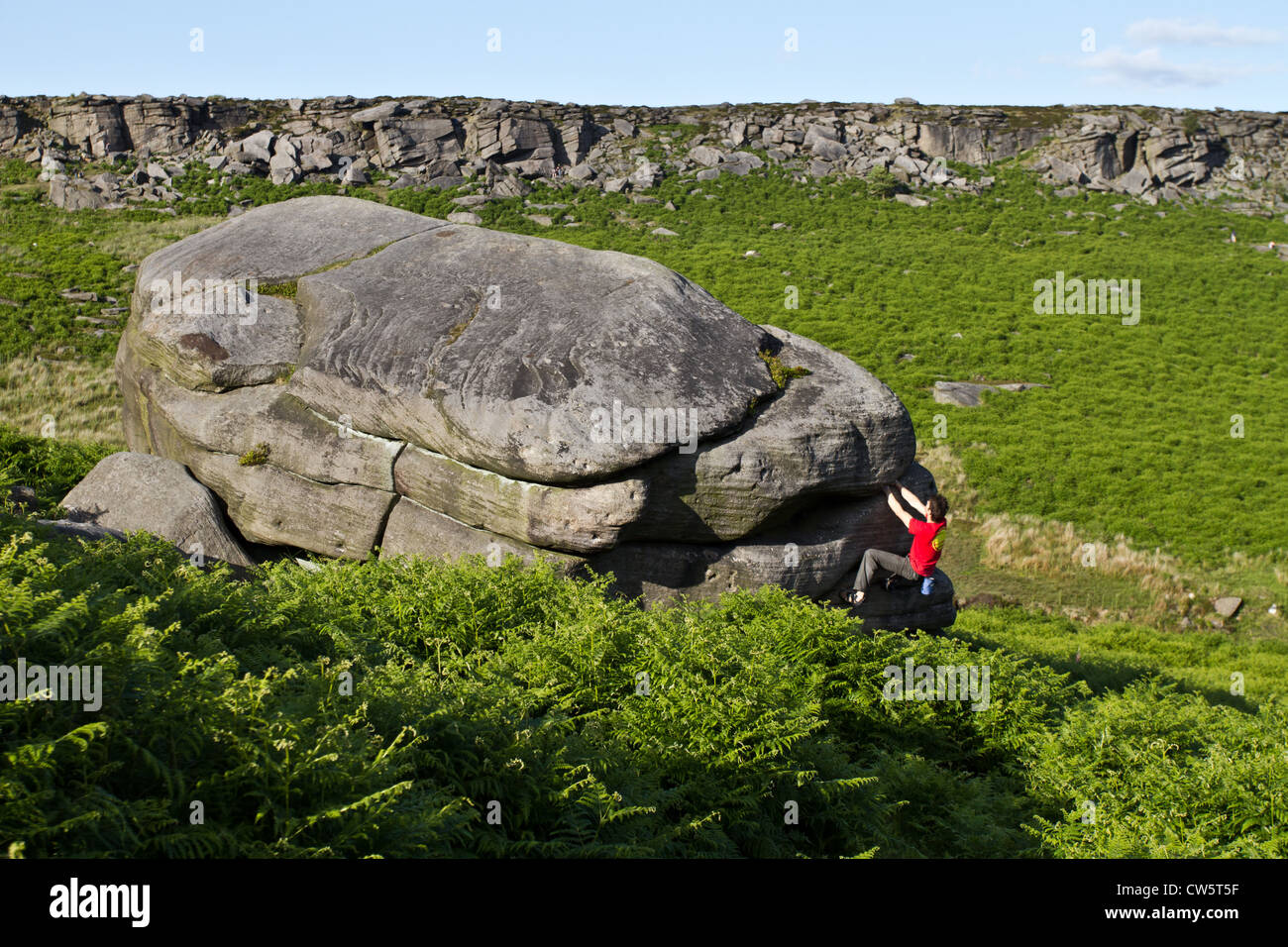 Tom Randall rock climbs a crack at Burbage in Sheffield near Stanage on the Peak District National Park Derbyshire, Stock Photo