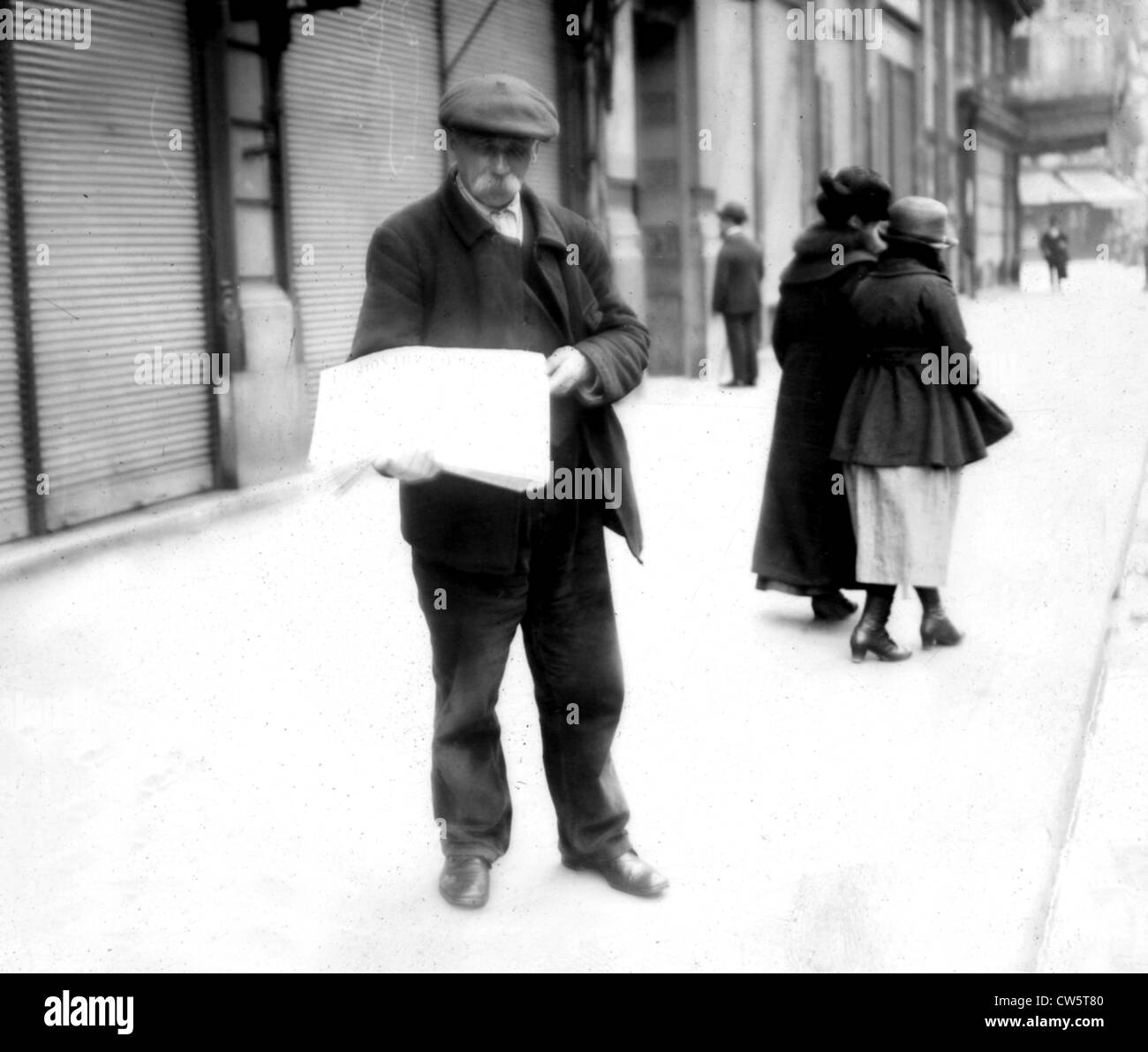 Salesman of 'l'Action française' newspaper - Stock Image