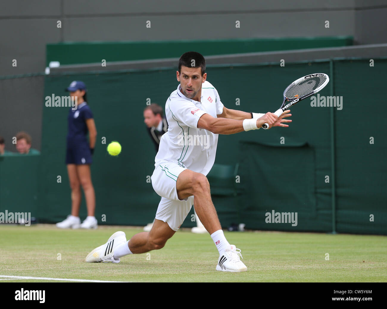 Novak Djokovic (SRB) in action at Wimbledon - Stock Image