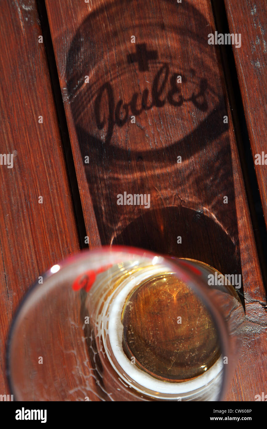 A pint glass with Joules beer and a shadow show the Joules beers logo - Stock Image