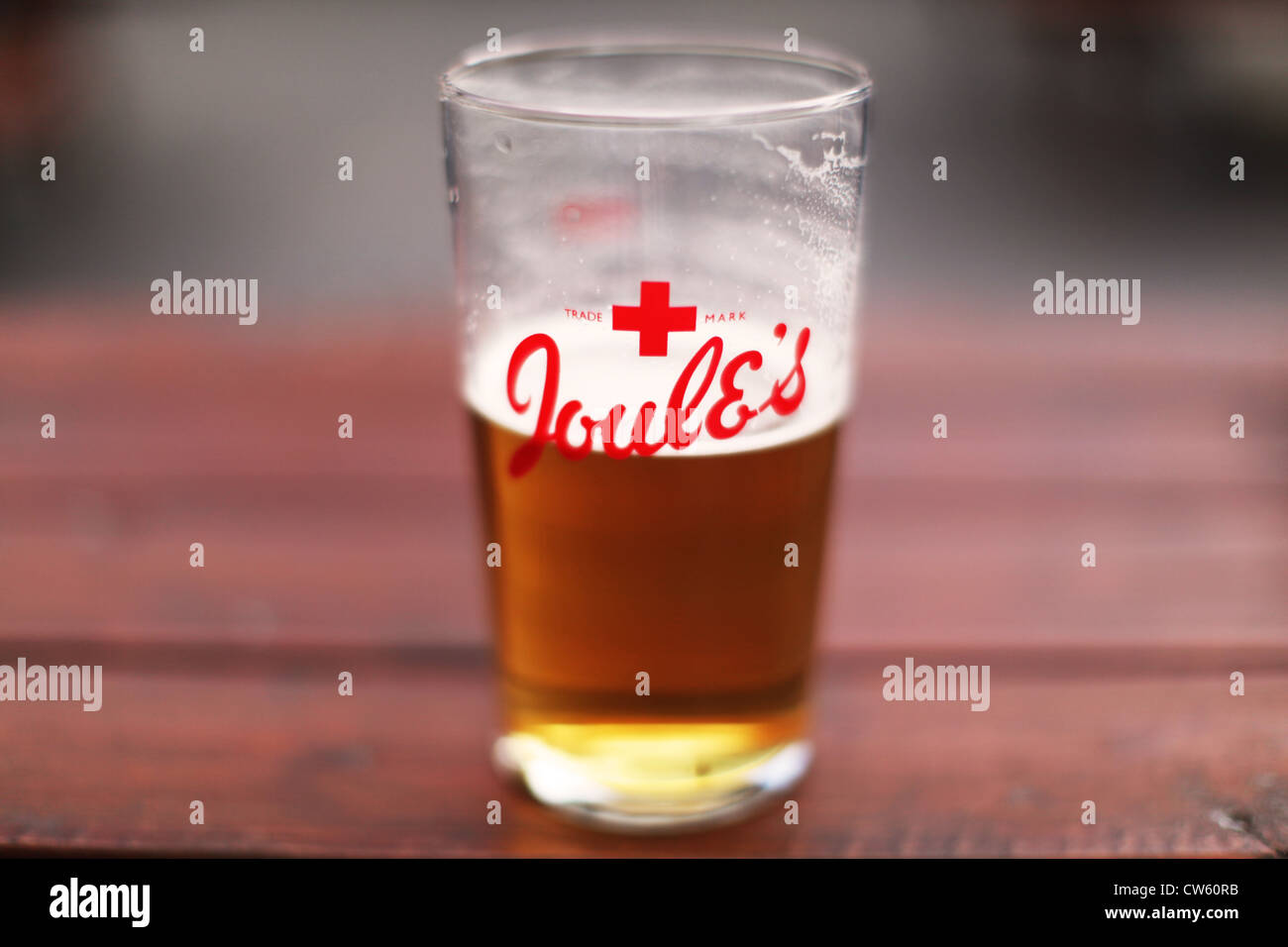 A pint glass with Joules beer on a pub table - Stock Image