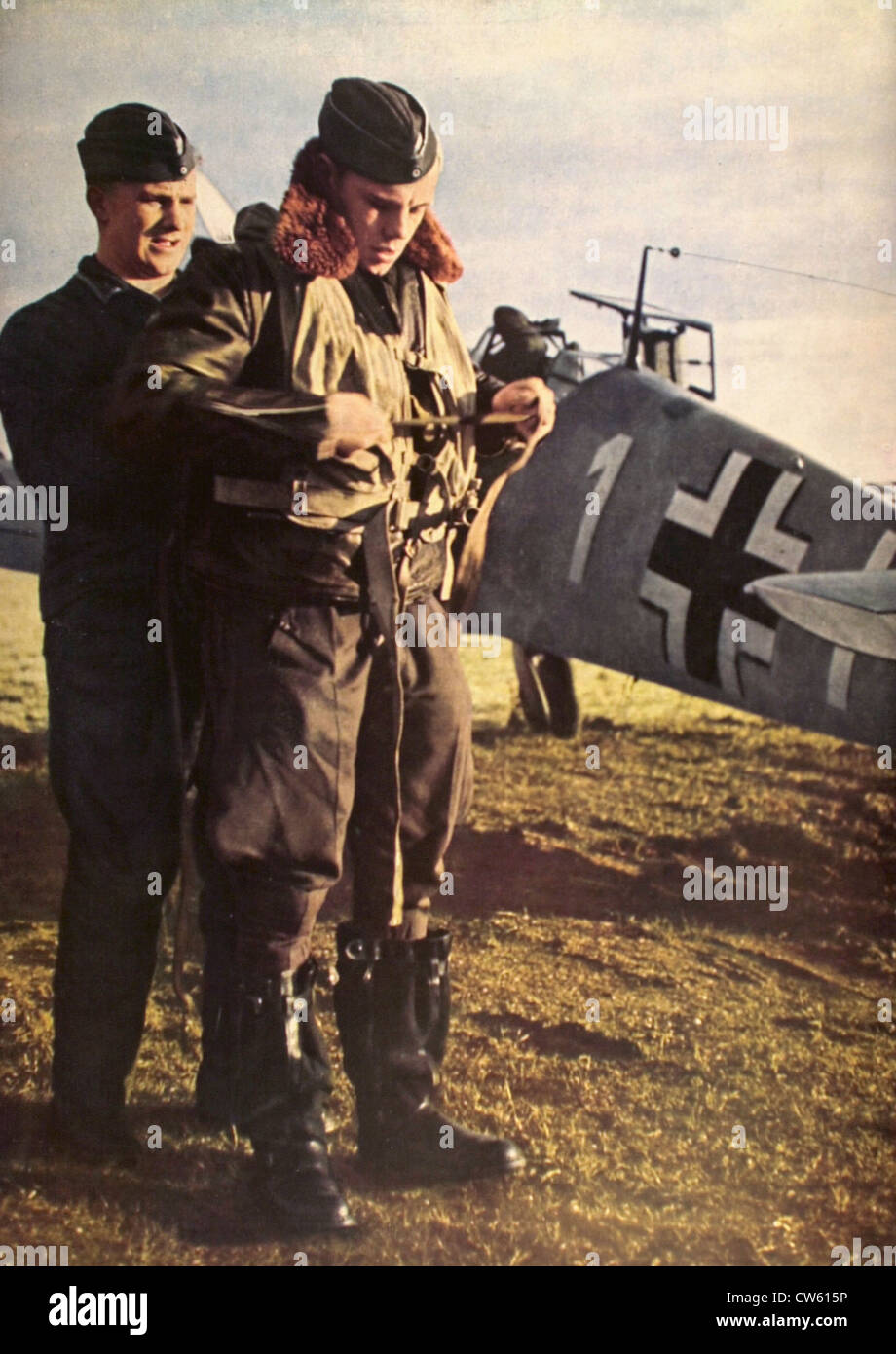 World War II. Checking the equipment of a German aviator before take-off (1941) - Stock Image