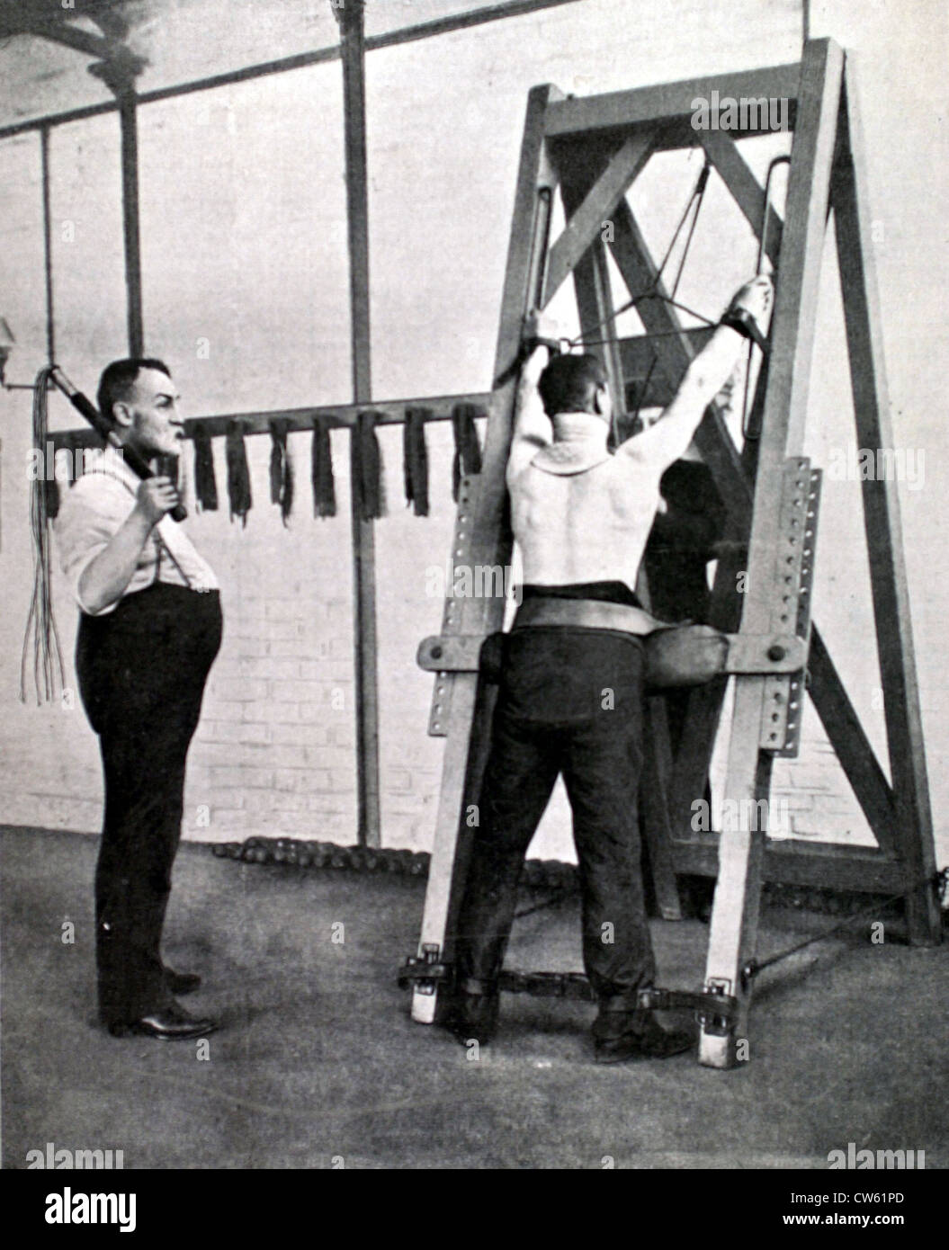 The 'cat-o'-nine-tails' torture in a prison of London (1910) - Stock Image