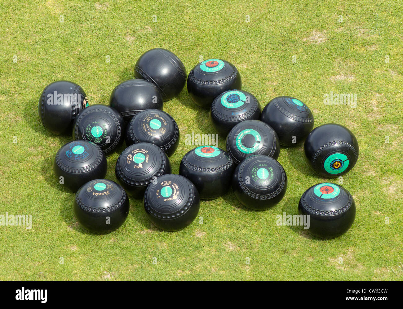 Lots of lawn bowls woods close up. - Stock Image