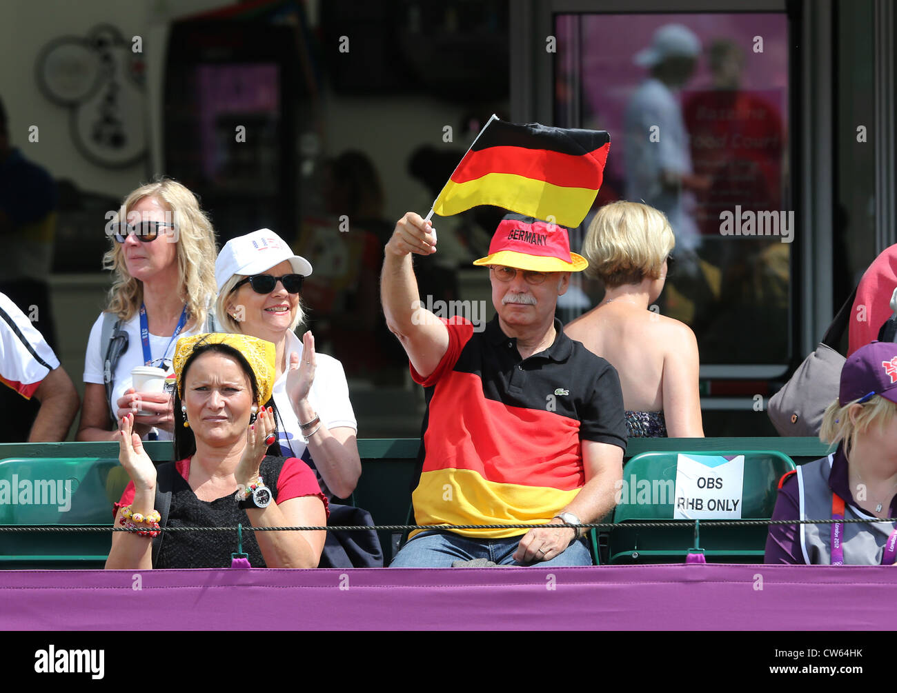 German fans with flag at the Olympic Tennis event at Wimbledon,London 2012, Stock Photo