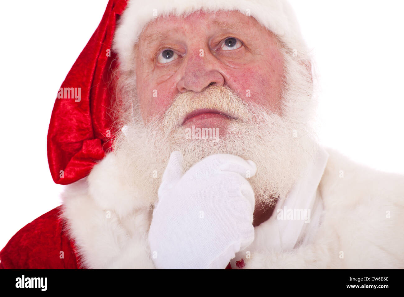 Portrait of Santa Claus deliberating a decision. All on white background. - Stock Image