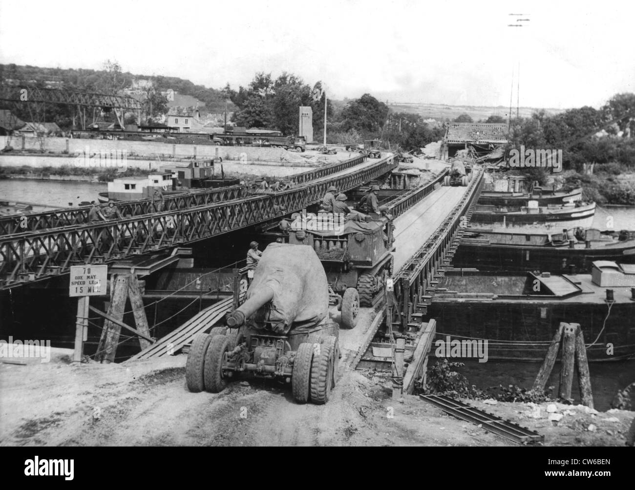 US 155 mm. gun across a Bailey Bridge over the Seine river in France (Summer 1944) - Stock Image