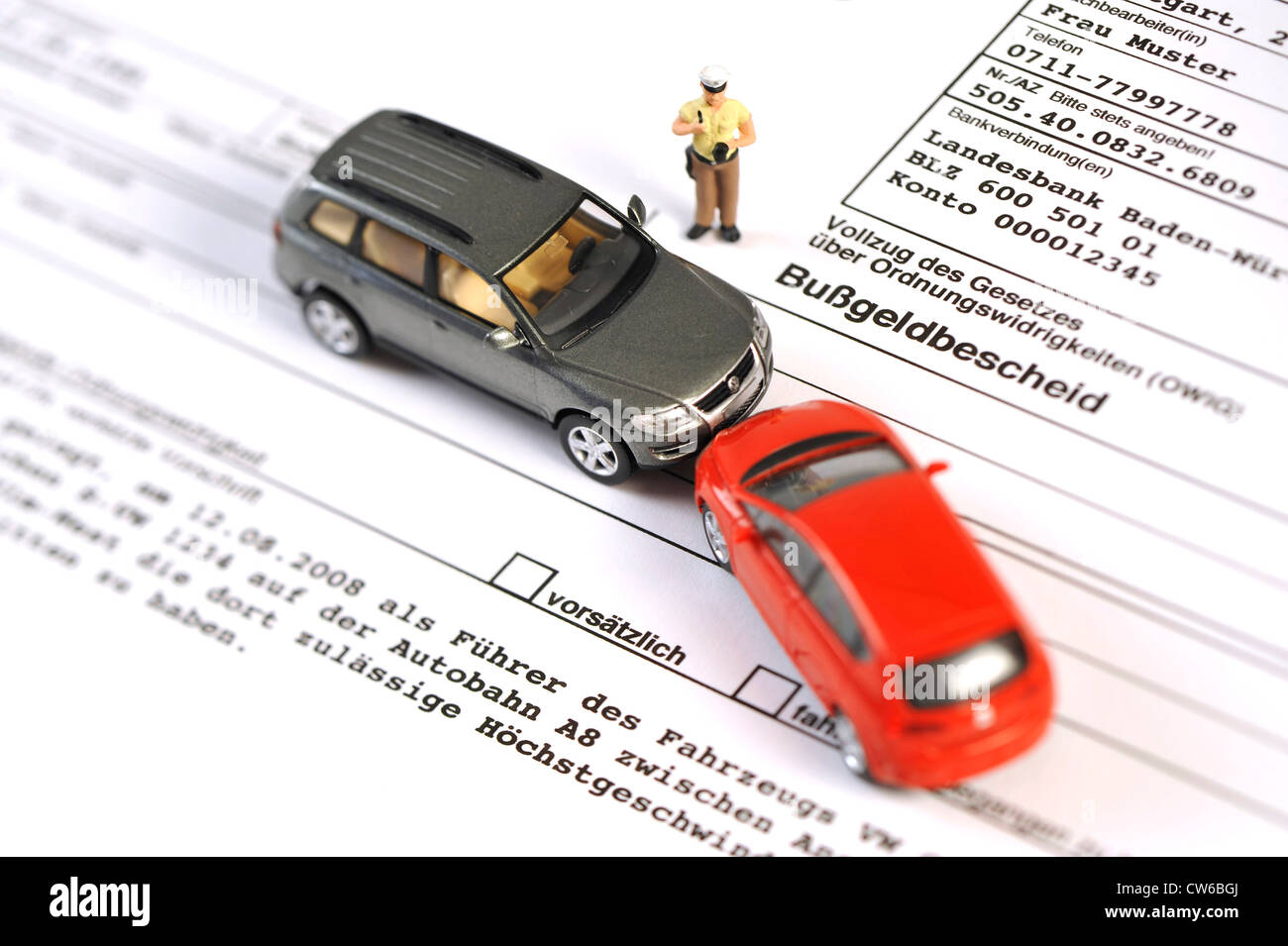 symbolic picture: acquisition of accident data, little police man figure and model cars on a fine document - Stock Image