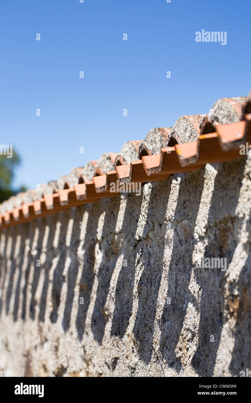 Shadow pattern made by French roof tiles. - Stock Image