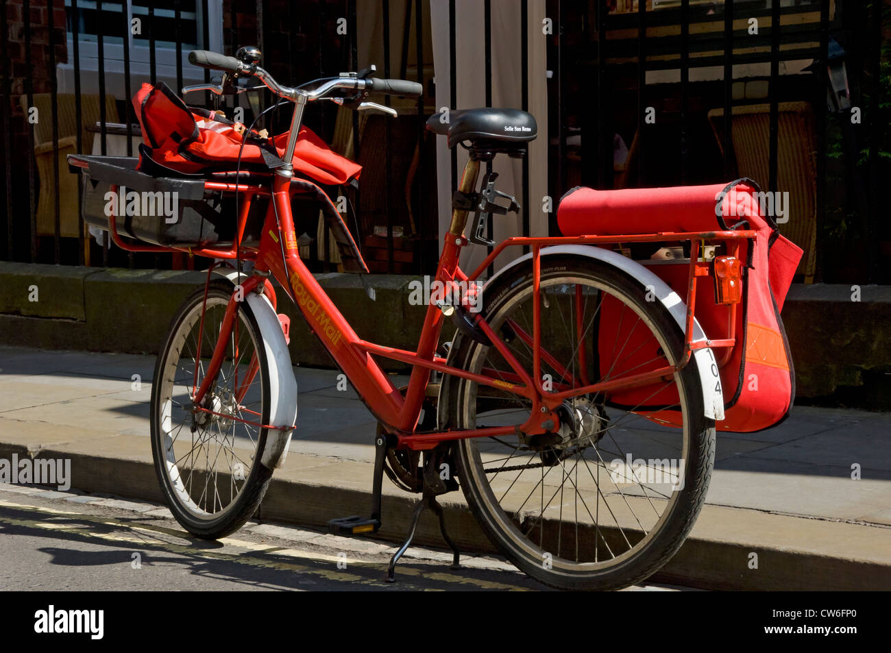 Royal Mail bike parked on the edge of the road England UK United Kingdom GB Great Britain - Stock Image