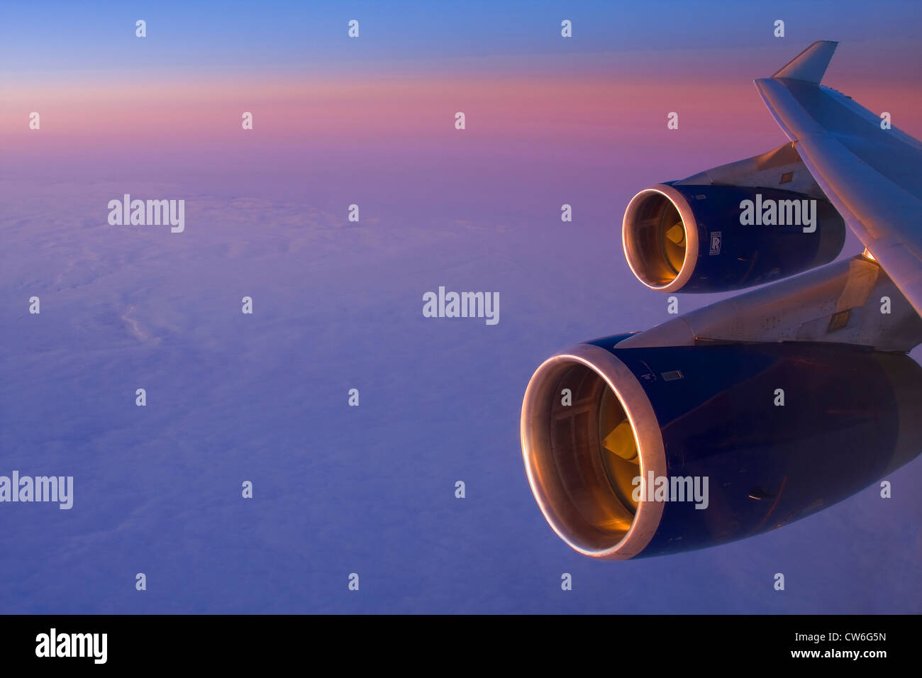 Boing 747in flight, Rolls-Royce engines shining in evening light - Stock Image