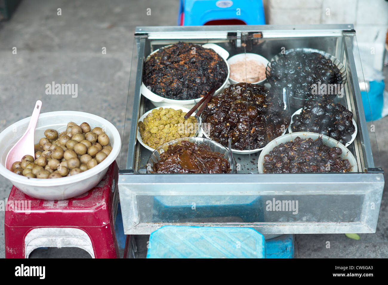 A variety of dried and preserved fruits on display by a street vendor - Stock Image