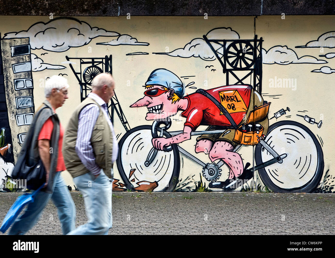 mural, doped cyclist drives in glass, Germany, North Rhine-Westphalia, Ruhr Area, Marl - Stock Image
